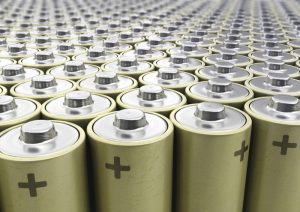 A landscape of batteries standing side by side like on a assembly line.
